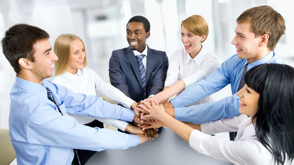 Stock image of business people in a huddle.
